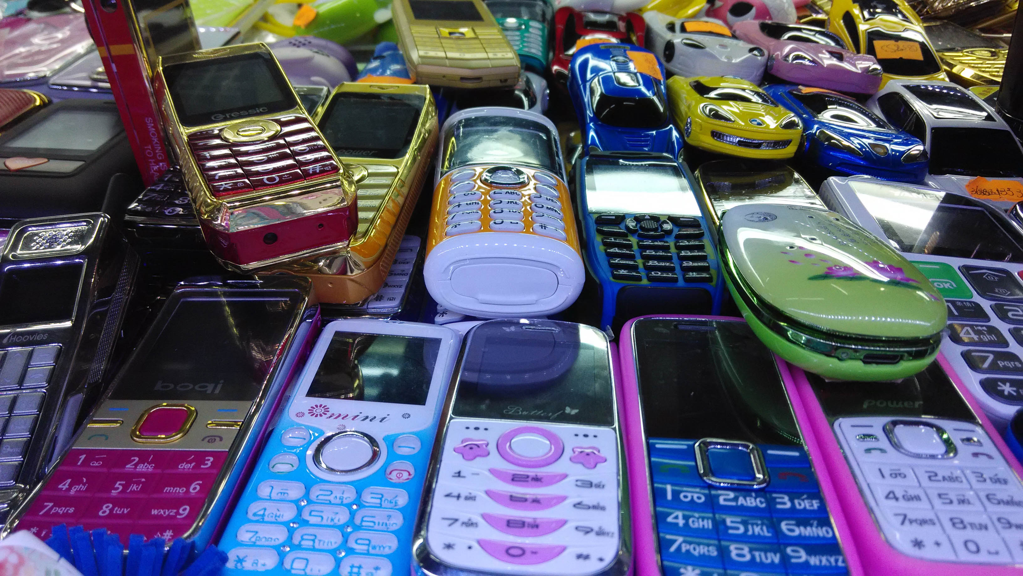 A selection of older counterfeit phones, now being phased out for super fakes
