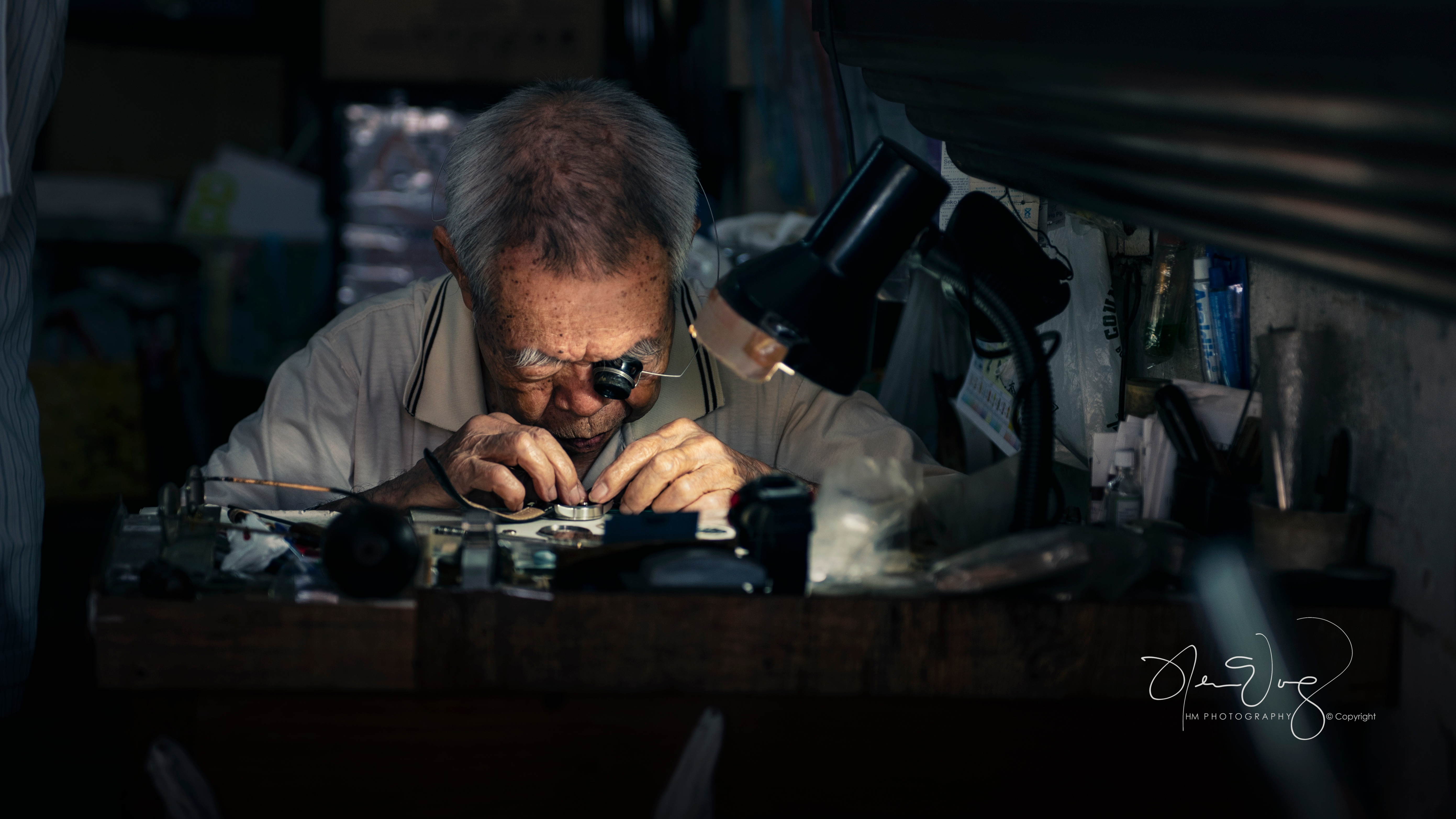 A horologist hard at work making a watch by hand