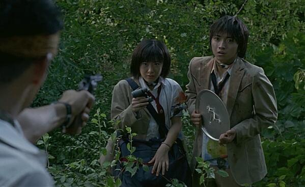Battle Royale's Shuya and Noriko - with the chicken pot lid