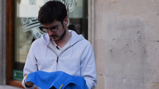 A fan investigating a fake Italian Rugby jersey