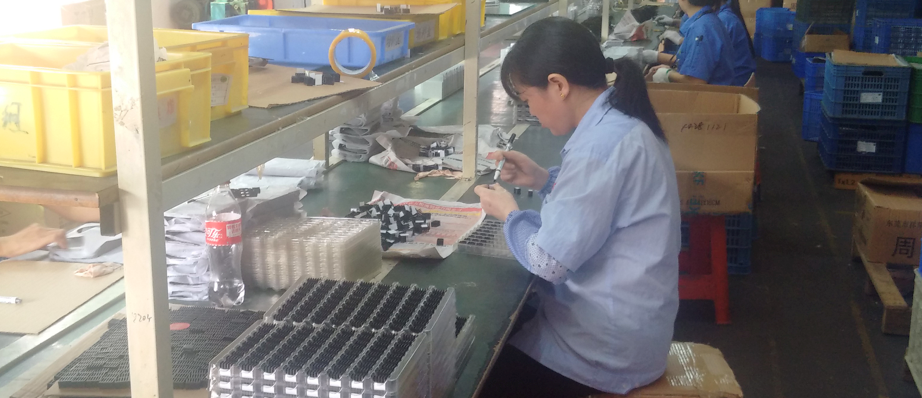 A shanzhai worker in Huaqiangbei, busy making knock-off products